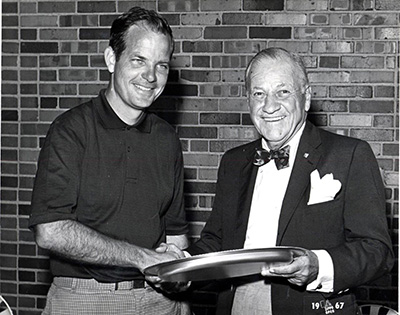 Mr. Blaisdell presents the trophy to the first winner, Ted McKenzie of Philadelphia, PA.